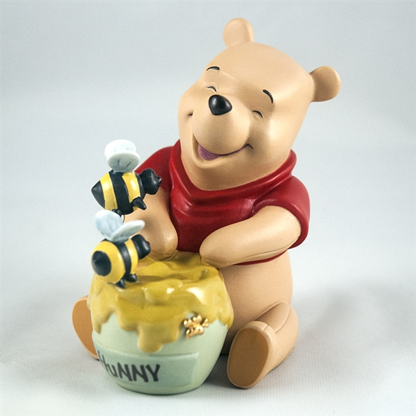 pooh friends with honey jar and bees figurine