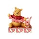 Disney Traditions Pooh and Piglet Making Hearts Figurine