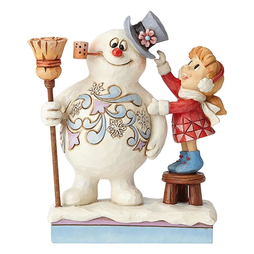 Karen Putting Hat on Frosty Figurine by Jim Shore