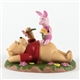 Pooh & Friends Laying in Flowers with Piglet Figurine, 4005063